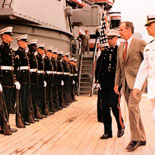 Vice President George H.W. Bush walking aboard IOWA during the recommissioning ceremonies in 1983