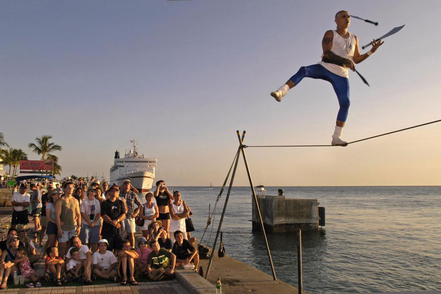 See the street performers at Mallory Square