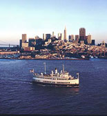The Bay, the San Francisco Skyline and a Hornblower Yacht