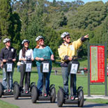 Golden Gate Park Segway Tour guide riding through by benches.