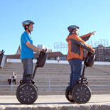 Gliding near Ghirardelli Square while exploring Fisherman's Wharf on a guided Segway Tour