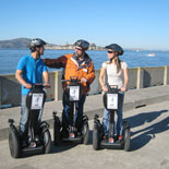 A guide and 2 guests enjoying a Fisherman's Wharf Waterfront Segway tour in San Francisco.