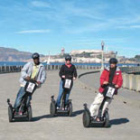 Riding i2 Segways on the Municipal Pier at the Aquatic Park - Alcatraz is in the background